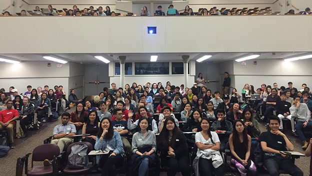 Students fill a lecture hall